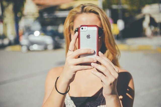 Girl taking picture with phone